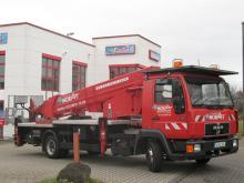 LKW-Arbeitsbühne / Hubsteiger mit einer Arbeithöhe 30 Meter mieten. Seitl. Reichweite 18,90 Meter, Tragkraft von 200kg